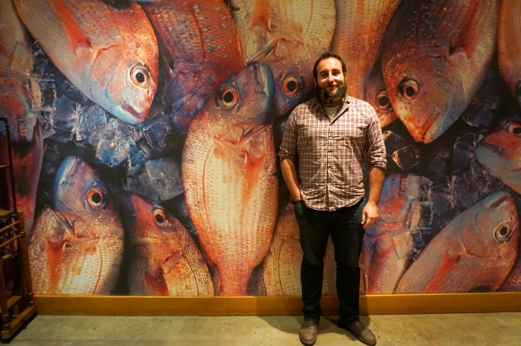 Zevi in front of Morimoto fish wall