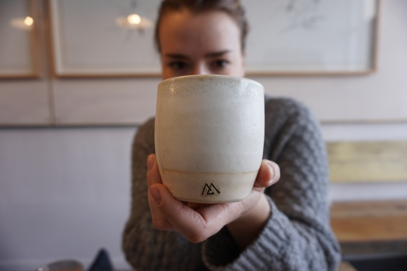 Monogram Coffee Julia holding cup